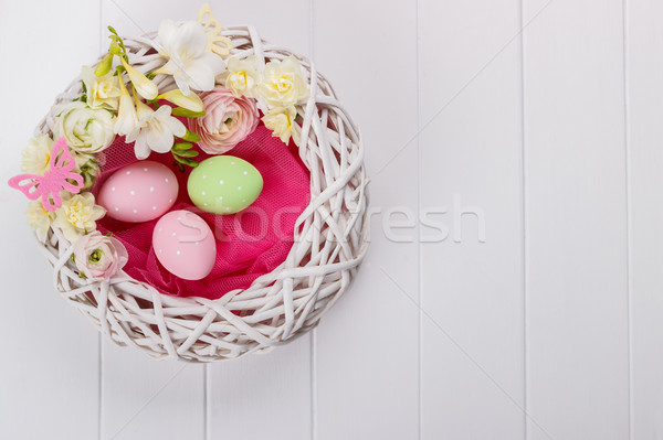Basket of easter eggs with flowers Stock photo © Lana_M