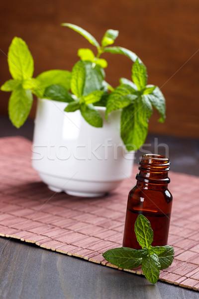 Menthe faible bouteille aromathérapie bois Photo stock © Lana_M