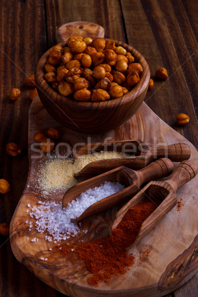 Roasted spicy chickpeas on rustic background Stock photo © Lana_M
