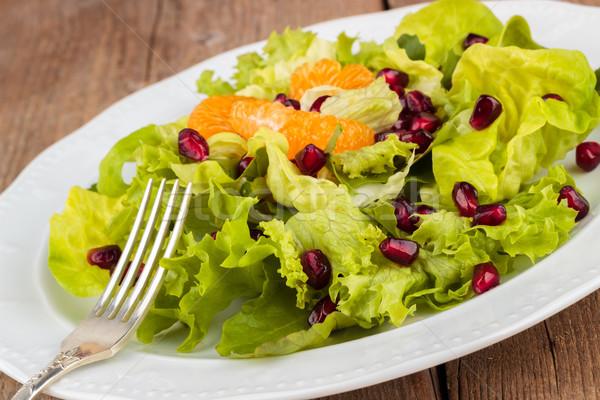 Gezonde salade granaatappel plaat ontbijt lunch Stockfoto © Lana_M