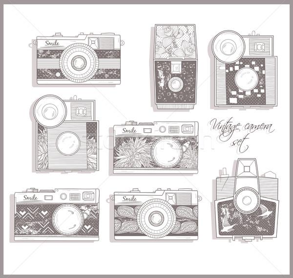 Retro photo cameras set. Vector illustration. Vintage cameras. Stock photo © lapesnape