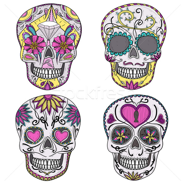 Mexican skull set. Colorful skulls with flower, heart ornament Stock photo © lapesnape