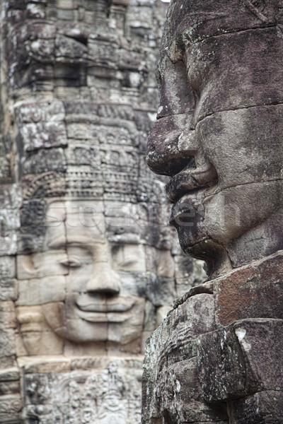 Templo faces angkor Camboja pedra tarde Foto stock © ldambies