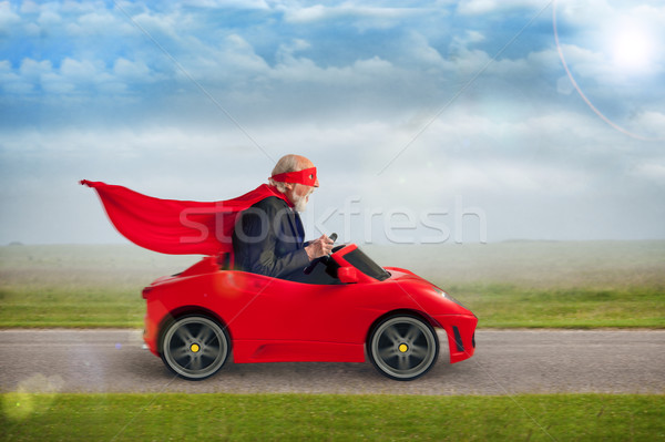senior superhero driving a toy sports car Stock photo © leeavison