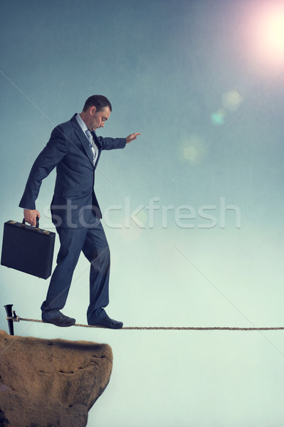 balancing businessman Stock photo © leeavison