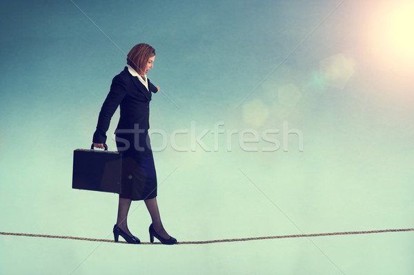 businesswoman on a tightrope Stock photo © leeavison