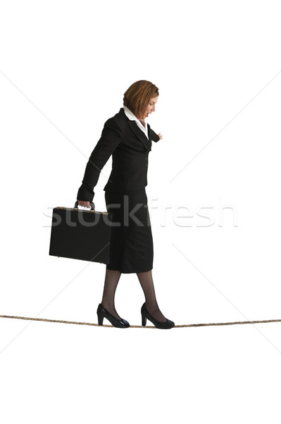 businesswoman balancing on a tightrope Stock photo © leeavison