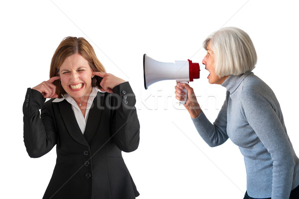 woman being yelled at by senior woman Stock photo © leeavison