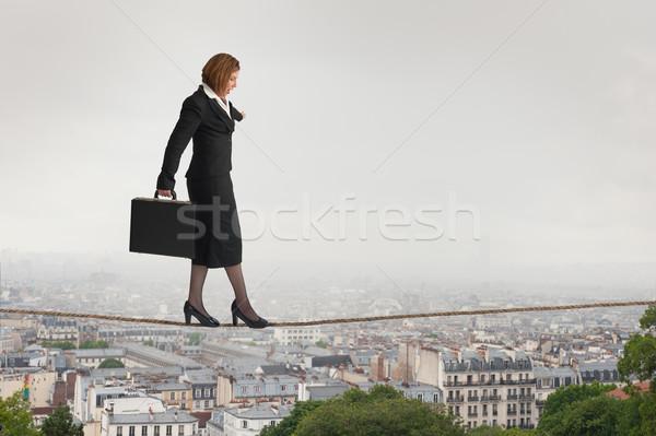 businesswoman walking a tightrope Stock photo © leeavison