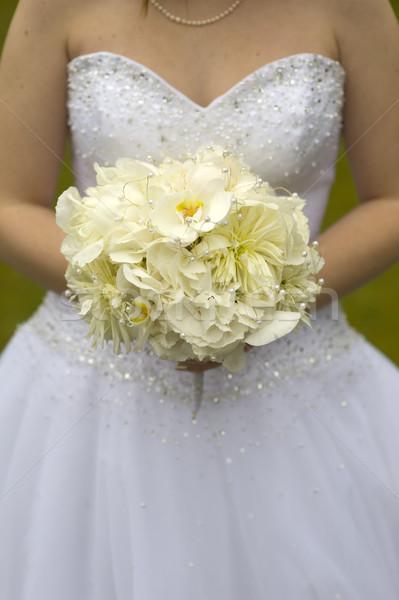 Menyasszony esküvői csokor tart orchideák nő kezek Stock fotó © leeavison