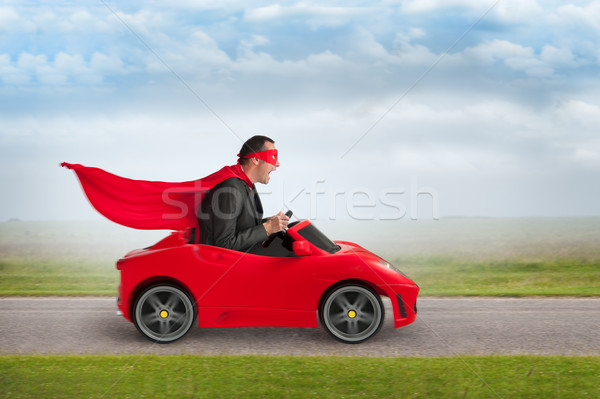 superhero man driving a toy racing car Stock photo © leeavison