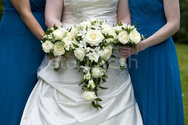 bride and bridesmaids holding wedding bouquets Stock photo © leeavison