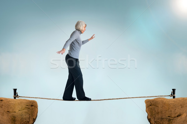 senior woman tightrope Stock photo © leeavison