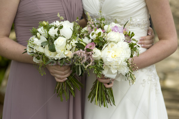 bride and bridesmaid with flowers Stock photo © leeavison