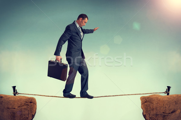 businessman balancing on a tightrope Stock photo © leeavison