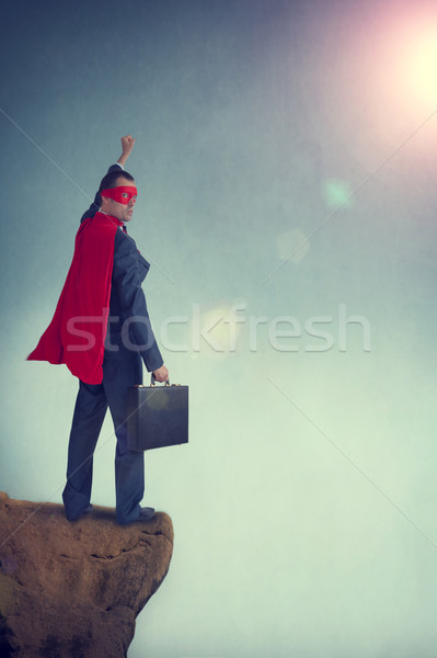 superhero businessman standing on the edge of a cliff Stock photo © leeavison
