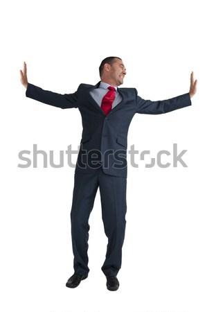 businessman pushing outwards isolated white background Stock photo © leeavison