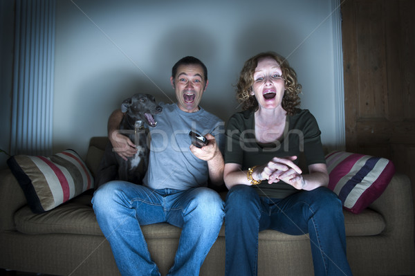 middle aged couple and dog laughing at the television Stock photo © leeavison