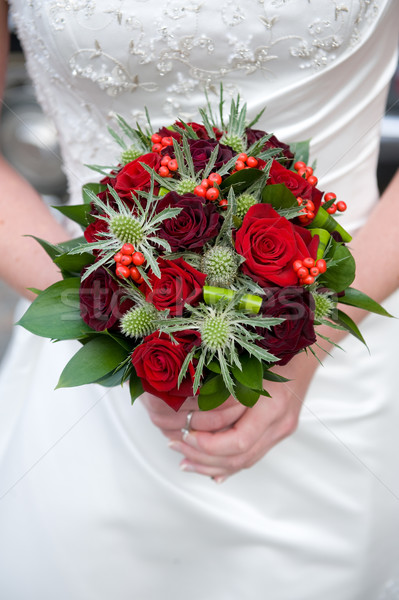 bride holding a bouquet of roses Stock photo © leeavison