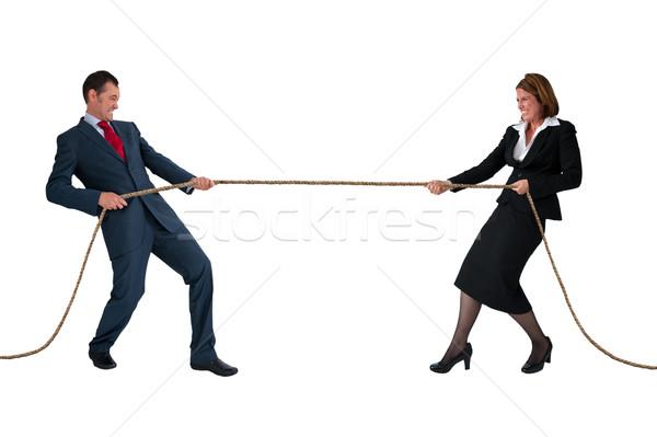 businessman and woman tug of war isolated on white Stock photo © leeavison