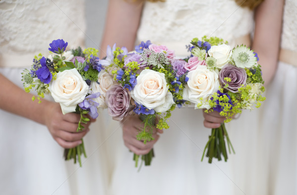 wedding bouquets held by bridesmaids Stock photo © leeavison