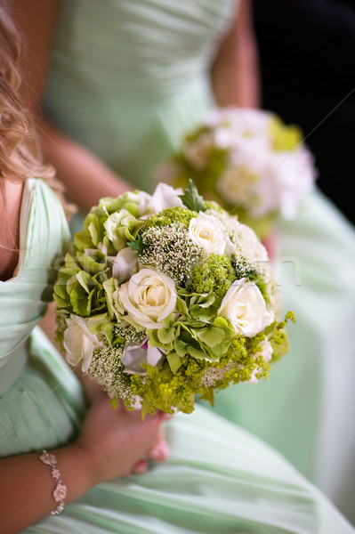 bridesmaids in green with wedding bouquet Stock photo © leeavison