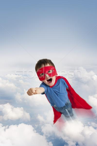 Superhero chłopca pływające niebo chmury dziecko Zdjęcia stock © leeavison