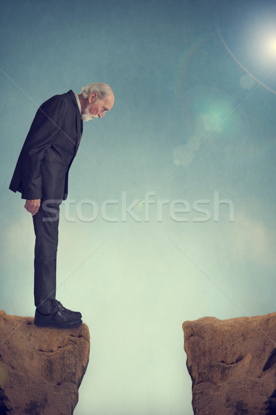 senior man looking down a crevasse Stock photo © leeavison