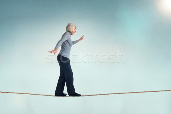 senior woman on a tightrope Stock photo © leeavison