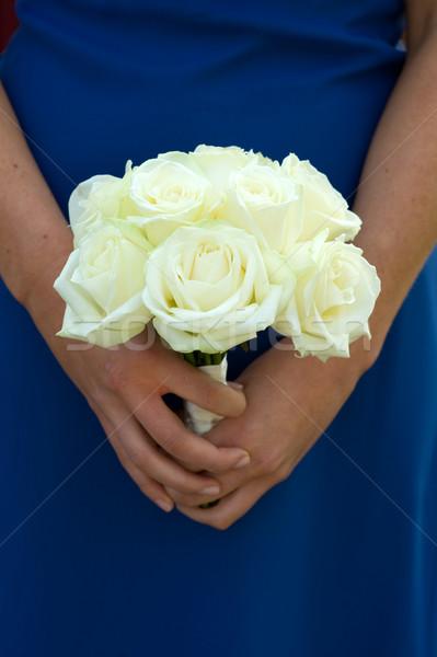 bridesmaid holding white rose wedding bouquet Stock photo © leeavison