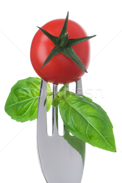 tomato and basil on a fork on white Stock photo © leeavison