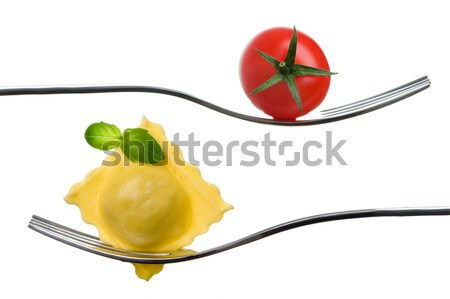 ravioli pasta parcel and spaghetti on fork white background Stock photo © leeavison