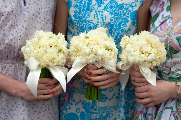three daffodil wedding bouquets held by bridesmaids  Stock photo © leeavison