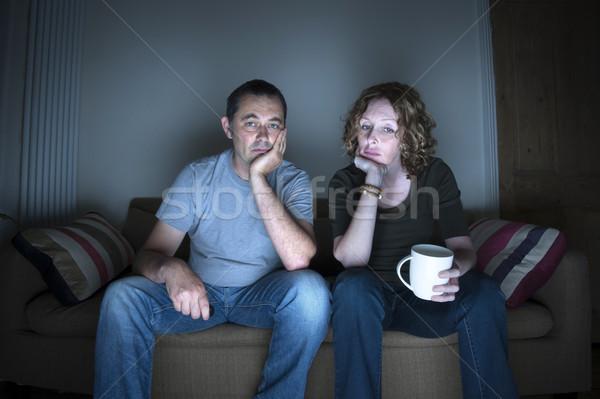Paar vervelen man televisie jeans Stockfoto © leeavison