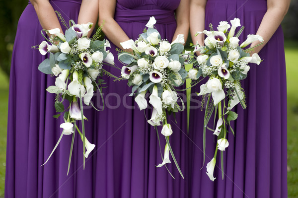 three bridesmaids holding wedding bouquets Stock photo © leeavison