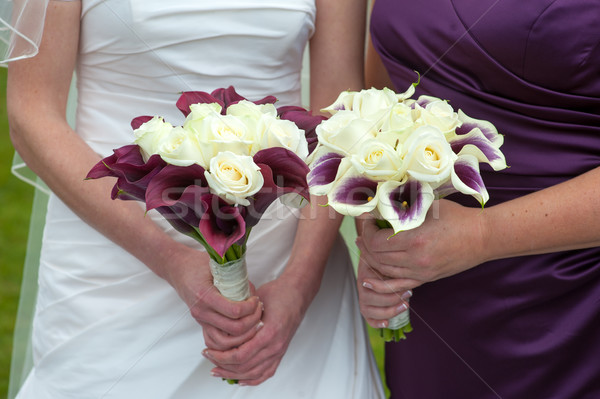 bride and bridesmaid with wedding bouquets Stock photo © leeavison