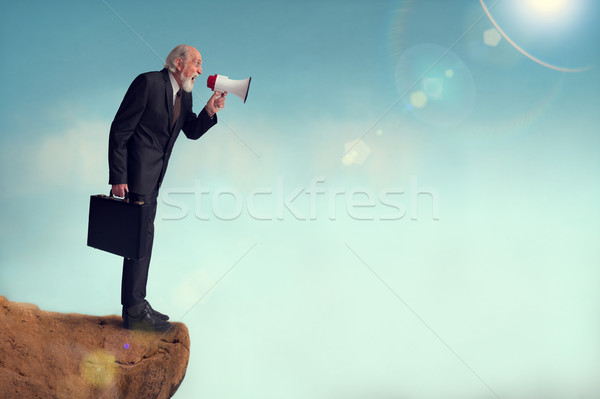 senior businessman yelling through a loudhailer Stock photo © leeavison