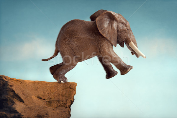 Stock photo: leap of faith concept elephant jumping into a void