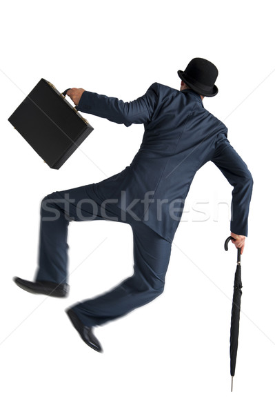 Stock photo: businessman jumping and kicking his heels isolated on white