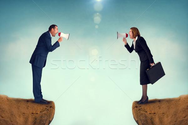 бизнеса конфликт мегафон бизнесмен деловая женщина человека Сток-фото © leeavison
