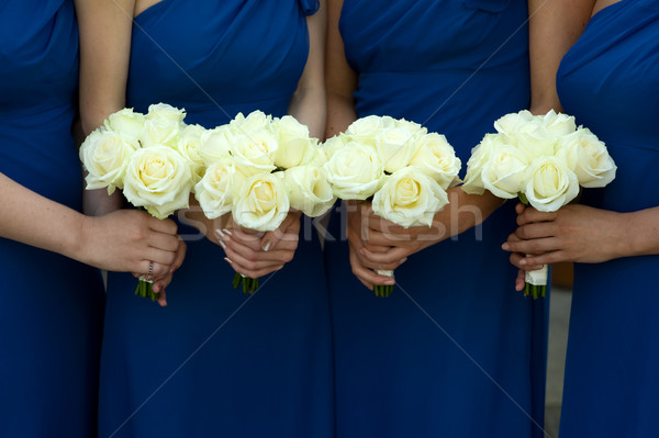 four bridesmaids holding white rose wedding bouquets Stock photo © leeavison