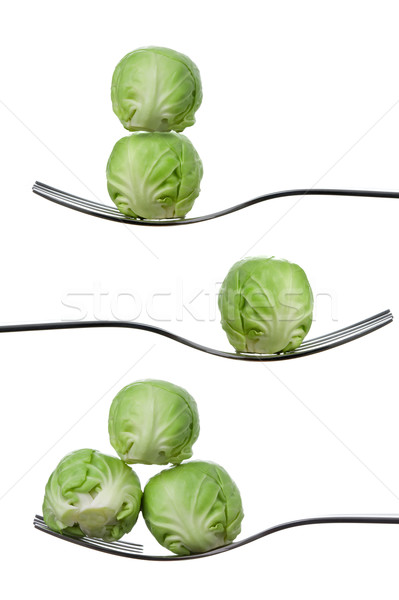 balancing brussel sprouts on forks against white Stock photo © leeavison