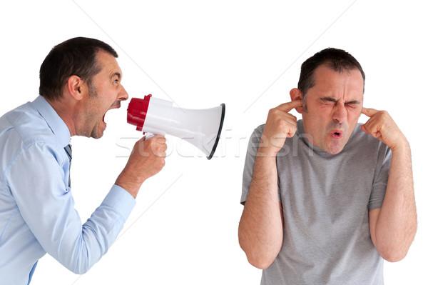 boss yelling at a subordinate megaphone Stock photo © leeavison