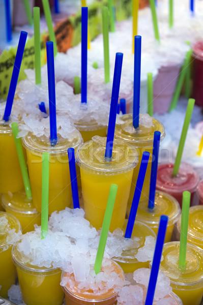 Dzsúz egymásra pakolva italok kirakat jég gyümölcs Stock fotó © leeavison