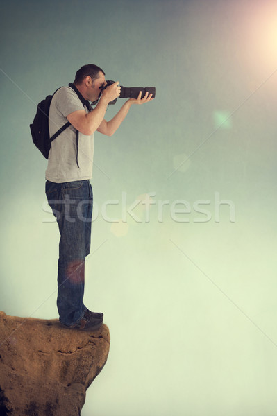 photographer on cliff ledge Stock photo © leeavison
