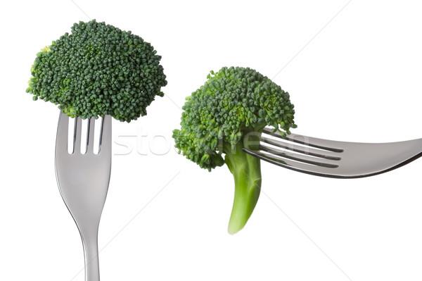 raw broccoli on forks isolated against white background Stock photo © leeavison