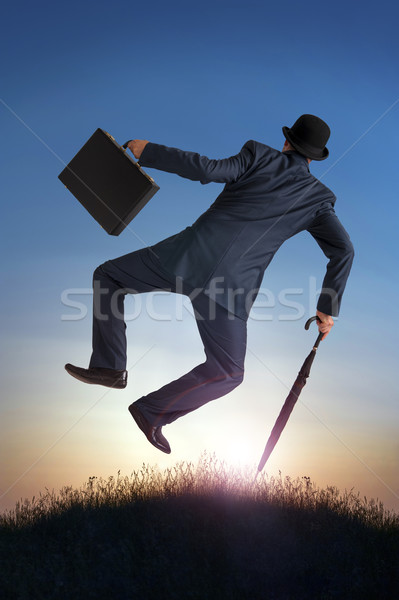 business success concept businessman kicking heels in air  Stock photo © leeavison