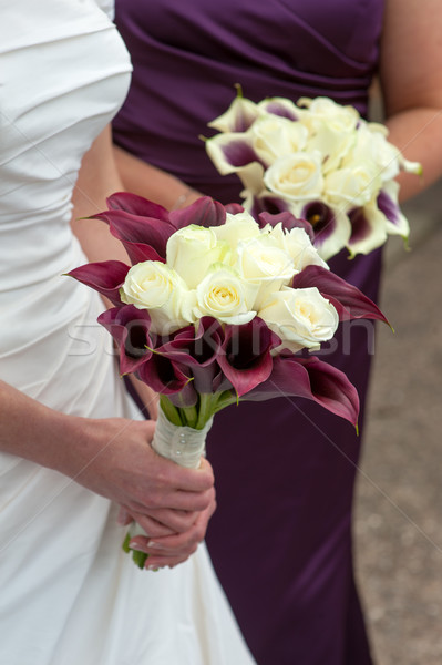 bride and bridesmaid with wedding bouquets Stock photo © leeavison