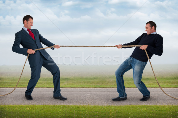tug of war between the same man Stock photo © leeavison
