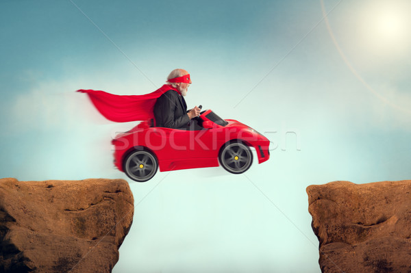 senior superhero driving a car off a ravine  Stock photo © leeavison